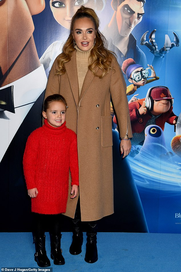Matching:Sophia matched her mother in a turtleneck dress and black boots and her hair was kept out of her face in a ponytail