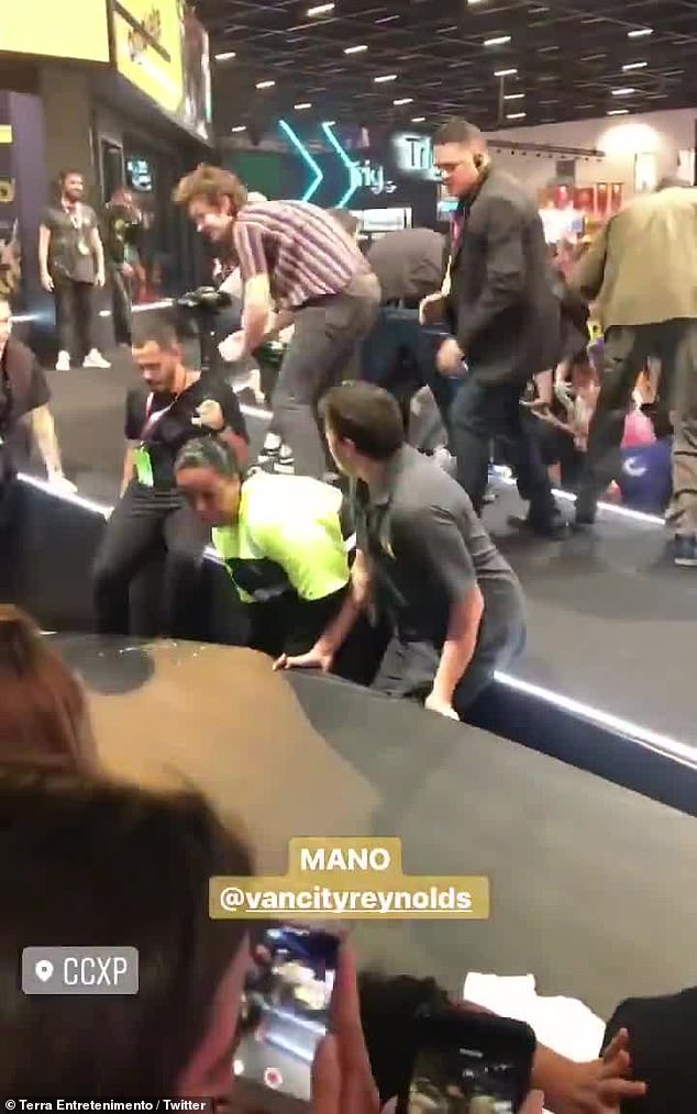 Mad scramble: Commotion ensued as stage workers checked to see if Reynolds and the fans were injured