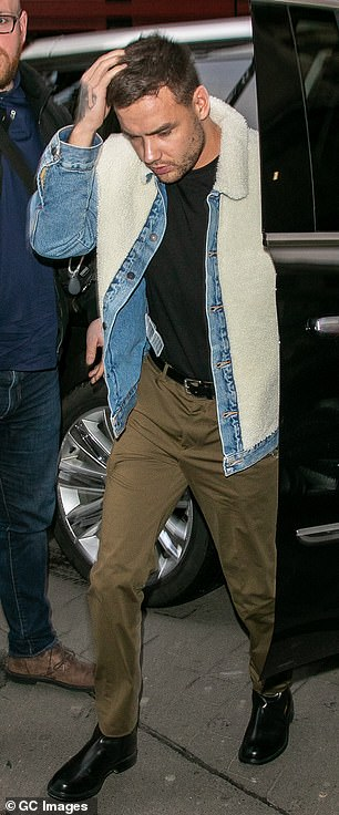Relaxed: The singer opted for a sheepskin denim jacket and khaki trousers for the outing