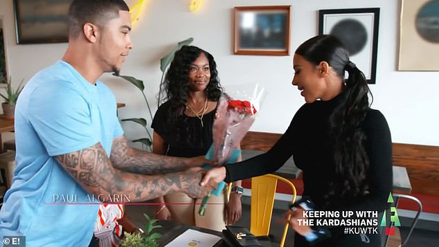 Meeting up: Paul gave Kim flowers and a card when they met