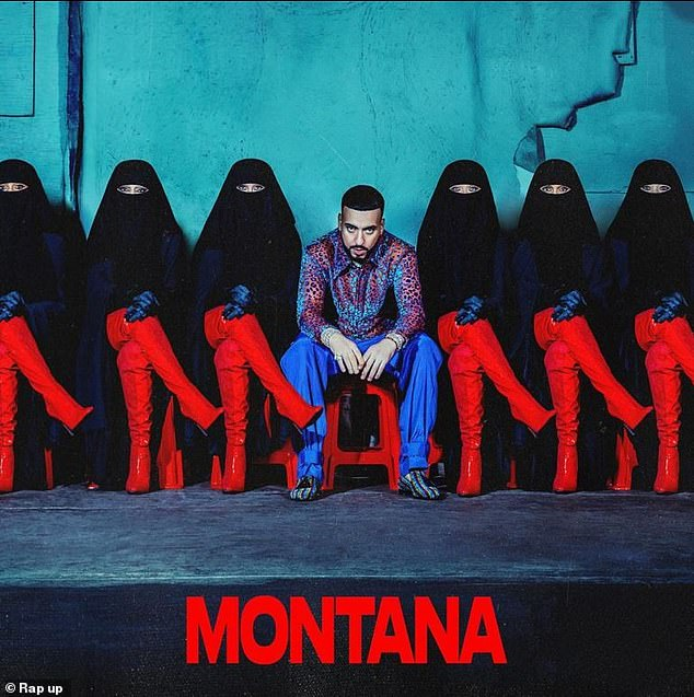 Muslim inspiration: He previously dropped the front cover art in September, showing him sitting in the middle of a row of women wearing black burqas and red thigh-high patent leather stilettos