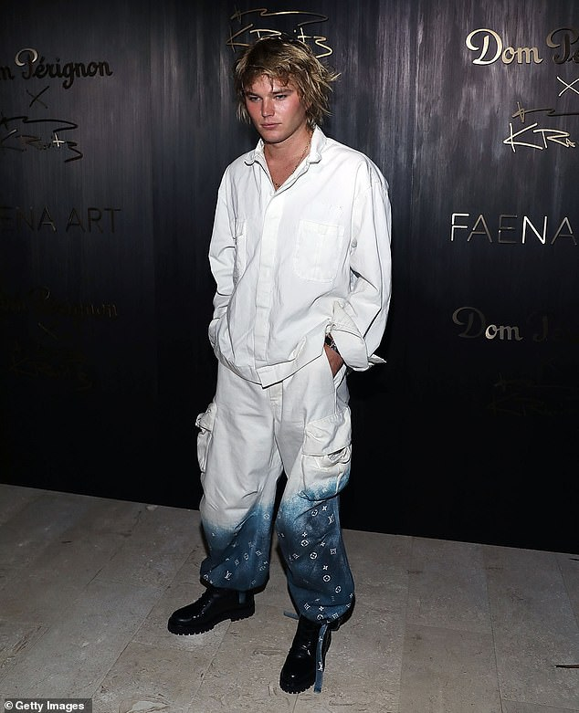 Looking good!The 23-year-old fashion sensation wore $2,880 Louis Vuitton denim pants as he attended the Art Basel showcase in Miami Beach