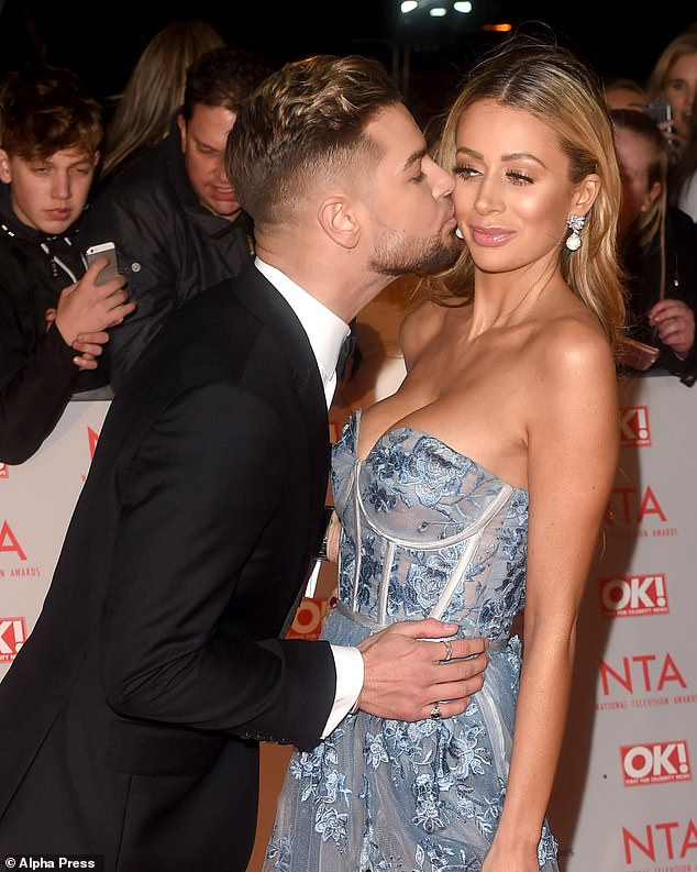Wow: Chris Hughes' ex Olivia Attwood appeared to mock his violent brawl at the National Television Awards on social media, two years after the former couple had their own spat at the event (above)