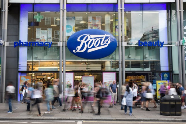 Members of the public walk past a branch of Boots the chemist on Oxford Street.