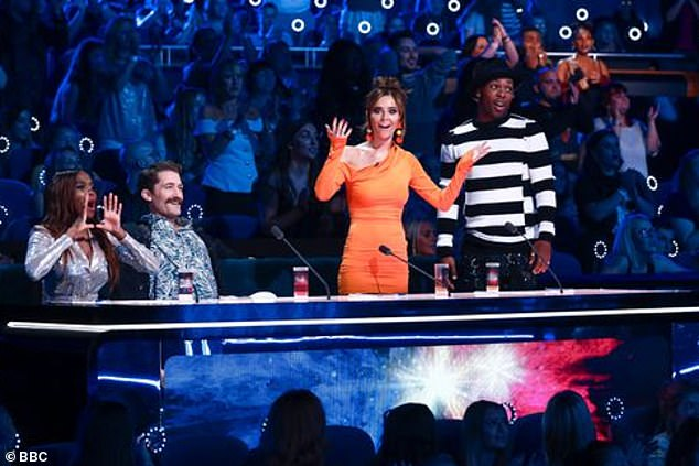 Wow: Cheryl, 36,flaunted her curves in a orange bodycon dress for Saturday night's episode of The Greatest Dance (also pictured L-R Oti Mabuse, Matthew Morrison and Todrick Hall)