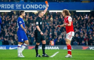 David Luiz protests as he is given a red card by referee Stuart Attwell.