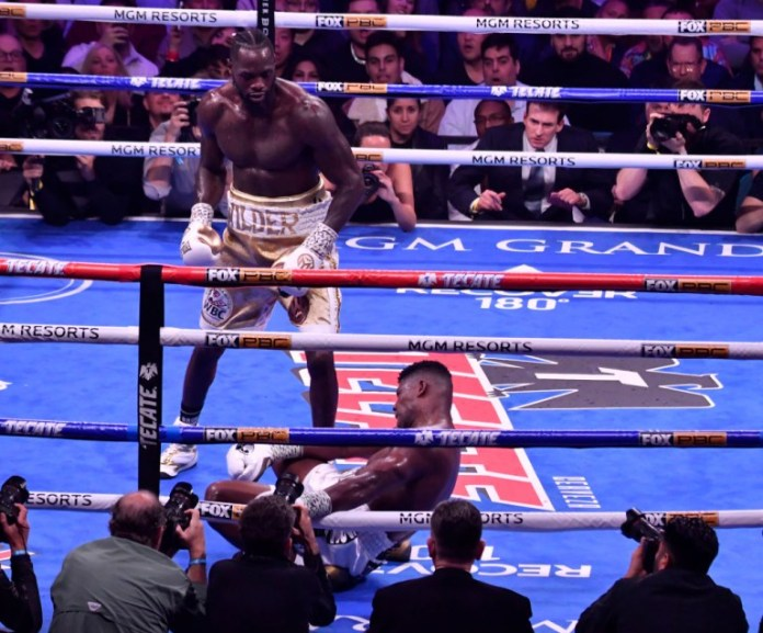 Deontay Wilder stands over an unconscious Luis Ortiz in their heavyweight fight