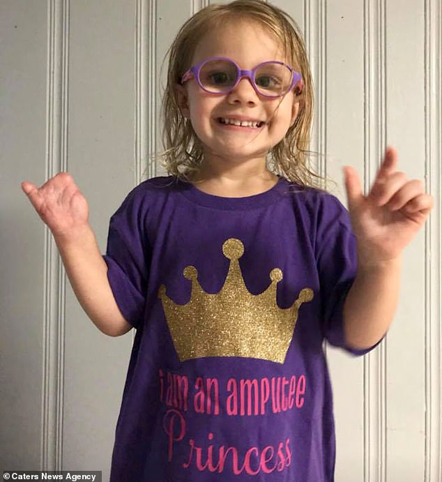 Aubry Harper, from Alabama, was just two when a lightbulb exploded in her hand and she suffered the life-changing injury. Here she wear a top that says 'I am an amputee princess'