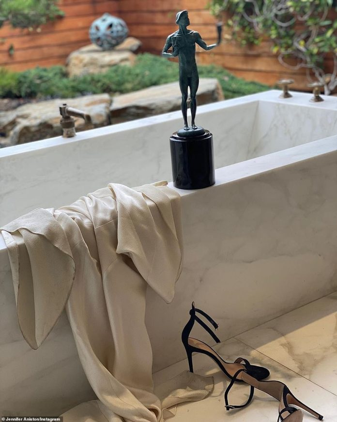 Since she opened her Instagram page three months ago, Jennifer Aniston has been sharing peeks at her incredible $21 million Bel Air mansion. The 50-year-old actress most recently revealed her immaculate bathroom on Monday for her 'morning after' snap following the SAG awards