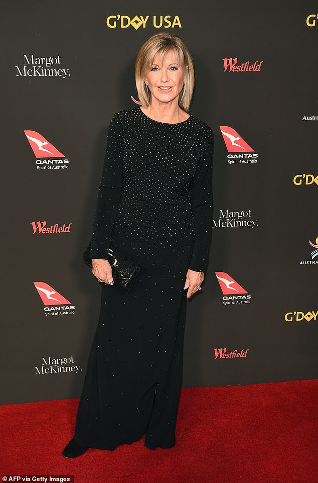'My tumours are receding': Olivia Newton-John, 71, (pictured) has given fans a health update amid her stage-four breast cancer battle... and talked her use of medicinal cannabis