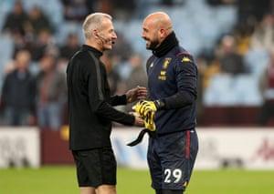 Aston Villa goalkeeper Pepe Reina with referee Martin Atkinson.