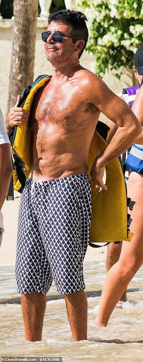 Looking good: Simon Cowell looked on fine form as he continued to showcase his newly slimmed-down physique while on a beach in Barbados on Saturday