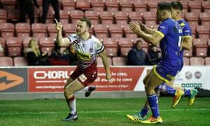 Liam Marshall celebrates his try.