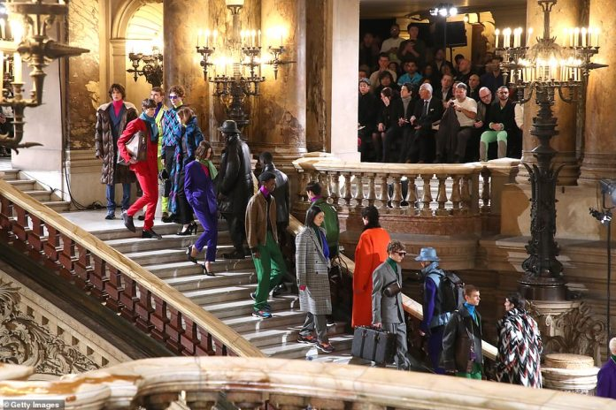 An image: The opera house's grand staircase was the centrepoint of the fashion show as the models showcased Berluti's latest looks