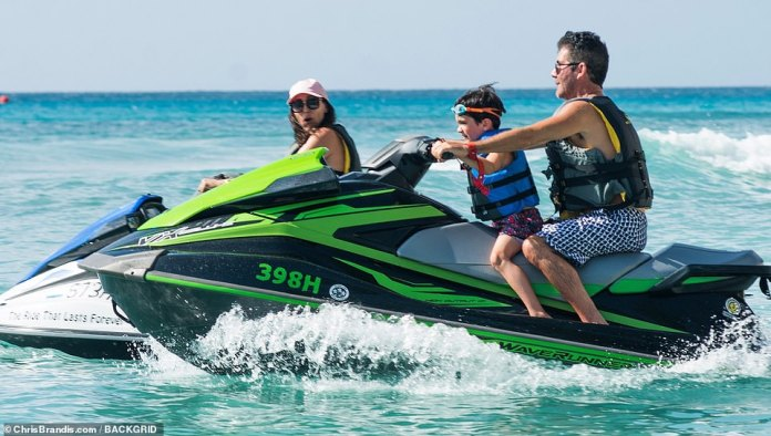 Life's a beach: Lauren, Simon and Eric enjoyed yet another thrilling jet ski ride during their long, annual holiday to Barbados