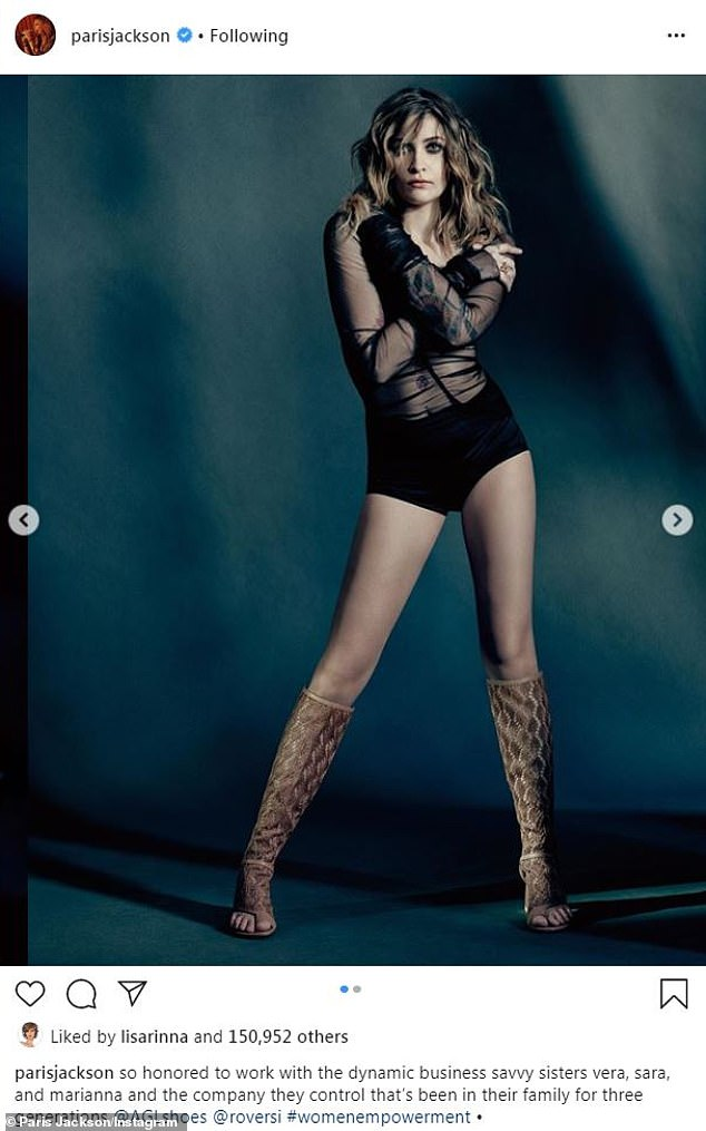 Legs eleven!Another shot had Paris flaunt her long and lean legs in a pair of snakeskin printed peep-toe boots