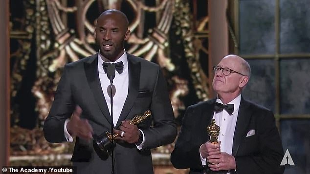 Triumphant: Bryant won Oscar gold for his 2017 autobiographical animated short film Dear Basketball, which he also wrote and voiced