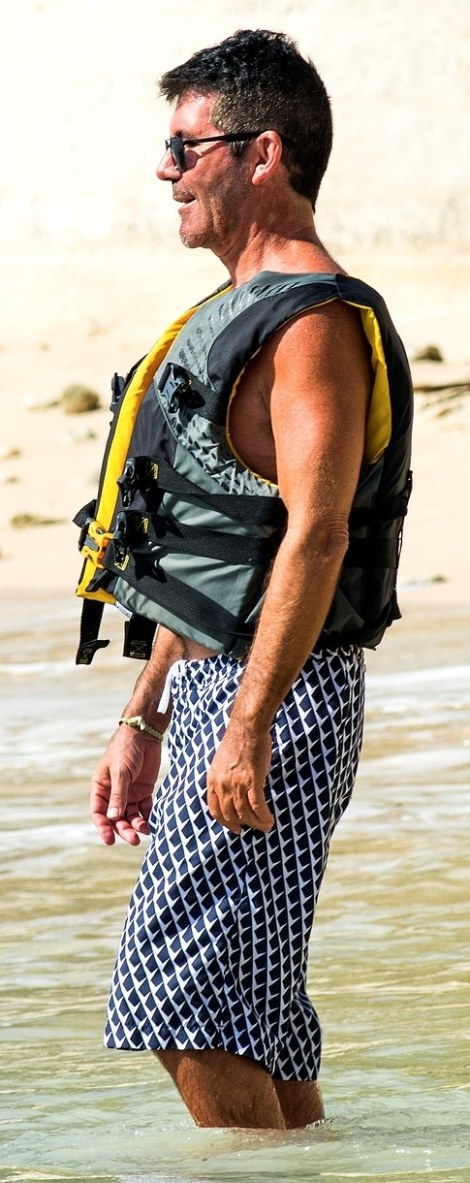 Beach bod: The TV judge looked happy and confident as he showed off his bronzed tan on holiday
