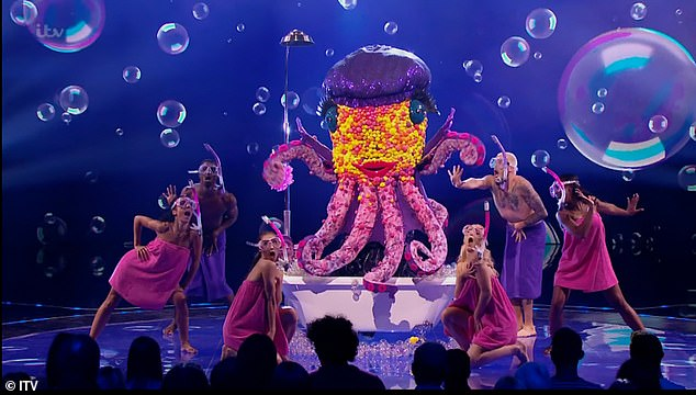 Close call: Before landing in the bottom,Octopus opened the show with a rendition of Bobby Darin's Splish Splash while posing inside a bubble bath