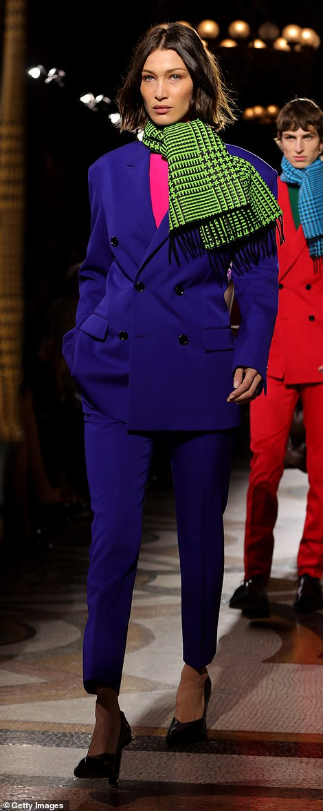 Strutting her stuff: The fashion superstar made a bold statement in her colourful ensemble