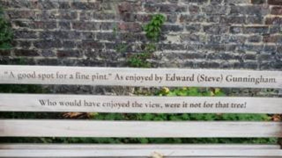 "Bench dedication that says: ""A good spot for a fine pint."" As enjoyed by Edward (Steve) Gunningham. Who would have enjoyed the view, were it not for that tree!"