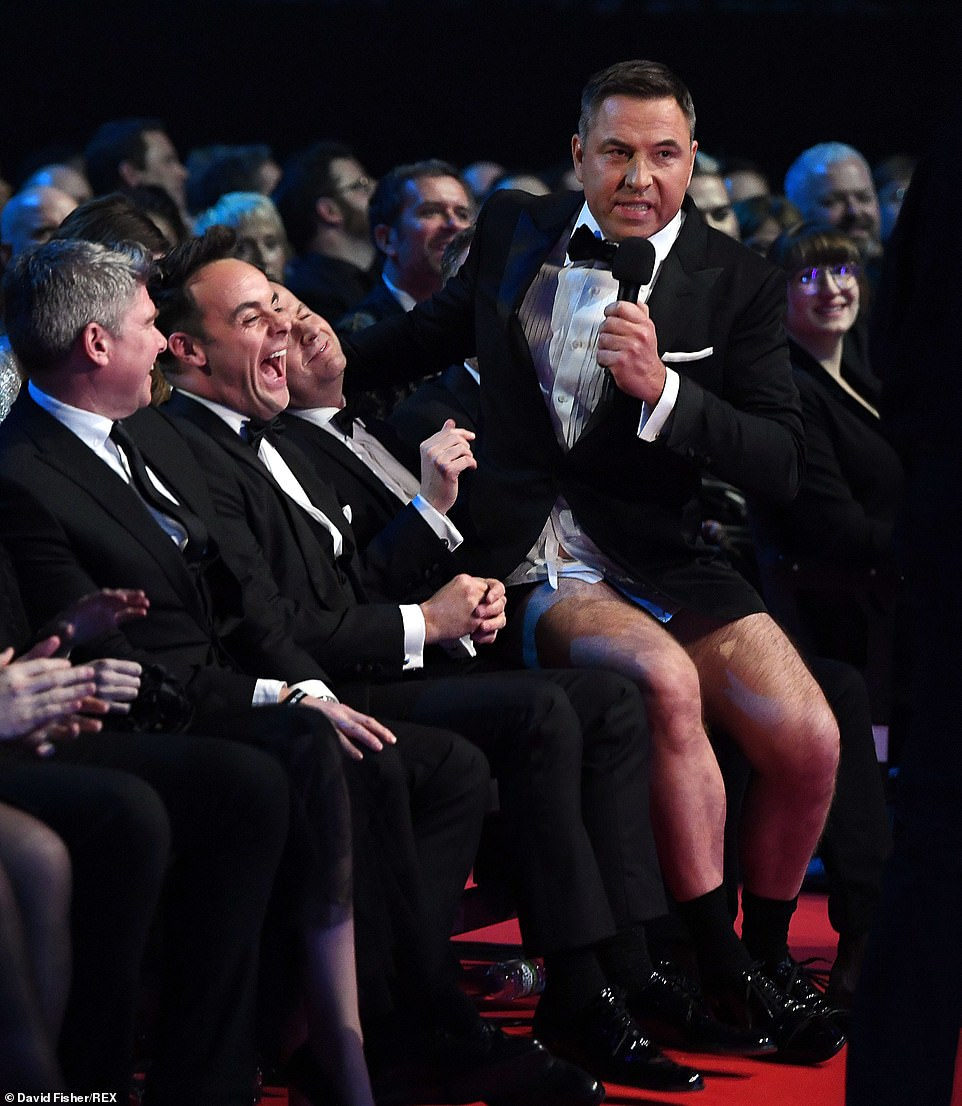 Sitting pretty:David sat on Ant & Dec's laps in the audience, in his pants, waiting to hear who the winner was