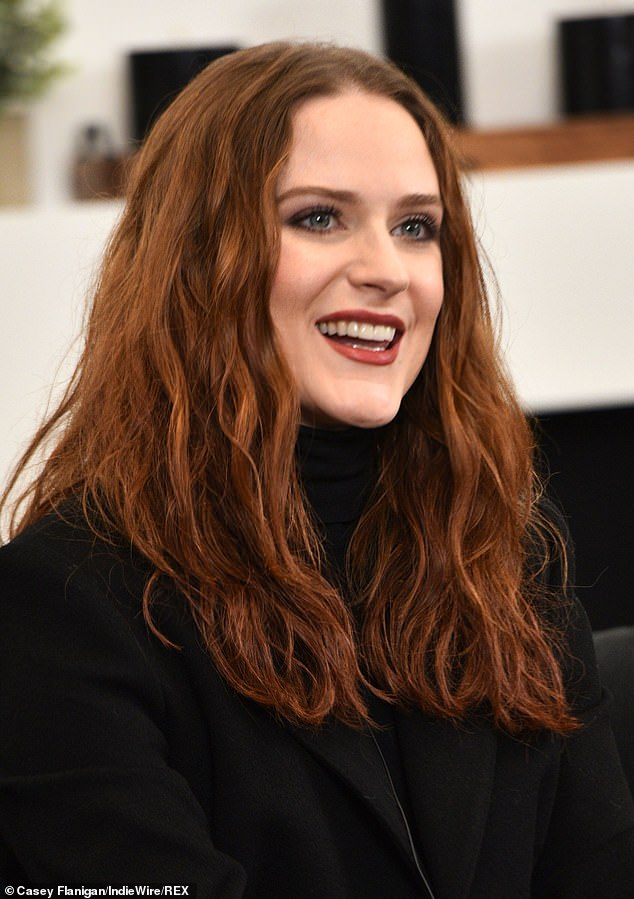 Gorgeous: Wood wore her tresses long and wavy, with a ginger tint and a part in the middle