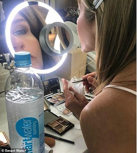 Jennifer's makeup station had a lit mirror