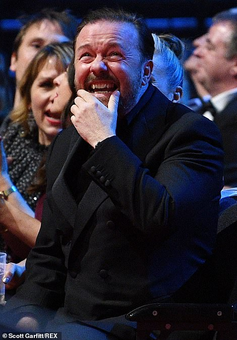 Shrugging it off! Ricky Gervais laughed off losing the Comedy Award to Mrs Brown's Boys