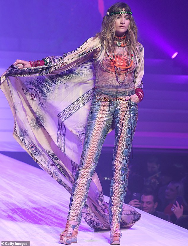 Layered in hippie madness: Jackson lit up the purple tinted runway in a pair of snazzy snakeskin print slacks that were well tailored. She added a shirt with an orange and purple hue and several beaded necklaces added. There were also red bracelets on her wrists