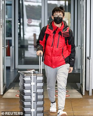 According to the Centers for Disease Control and Prevention, the woman traveled to Wuhan in late December and arrived back in the US on January 13. Pictured: Passengers wearing masks arrive at O'Hare International Airport on Friday