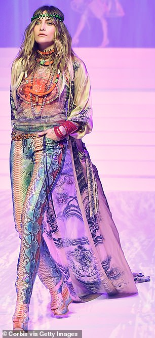 Colorful outfit: The colorful ensemble featured a flowing purple train