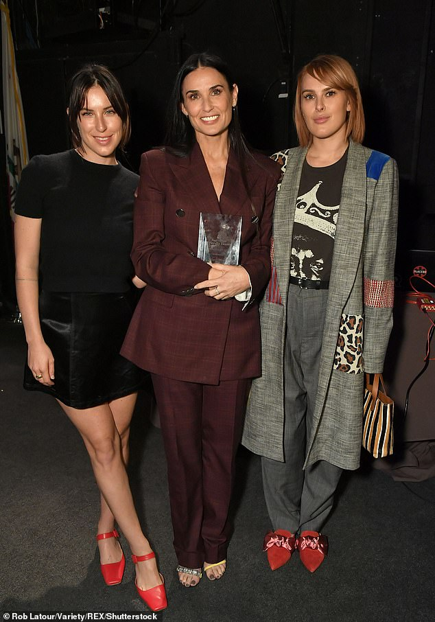 In the spotlight: The Willis daughters have continued to be open and honest about their personal struggles after growing up in the spotlight as the children of famed stars, Demi Moore and Bruce Willis (Scout and Rumer pictured with Demi in 2018)