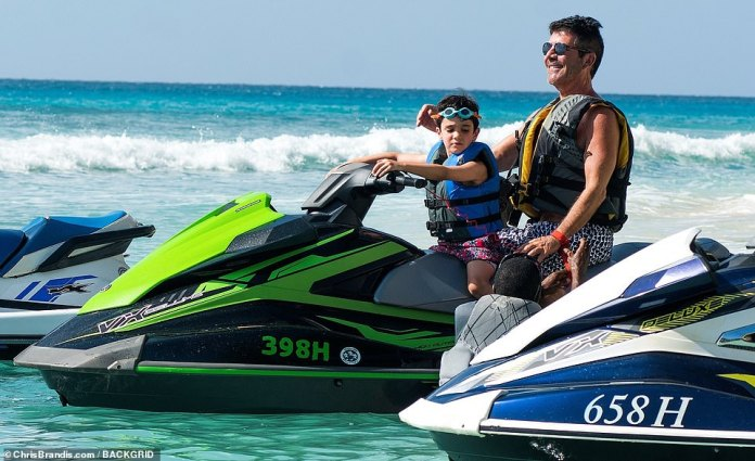 Waves: Simon looked chuffed as he sat on a jet ski with his beloved son