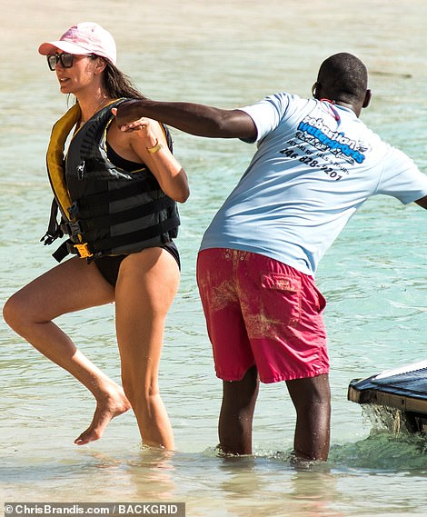 Fabulous: Lauren still managed to make getting assisted off a jet ski glamorous