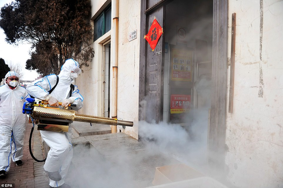 Volunteers in Qingdao, Shandong, are seen spraying disinfectant into local businesses in a desperate attempt to stop the coronavirus