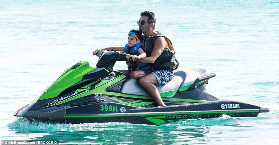 Wow: Simon showed off his jet skiing skills as he rode along with little Eric