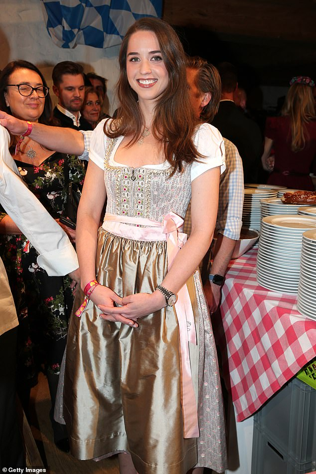 Joining in: Actress Christina, 28, also dressed suitably for the ocassion as she wore a traditional champagne coloured Dirndl at the fun-filled bash