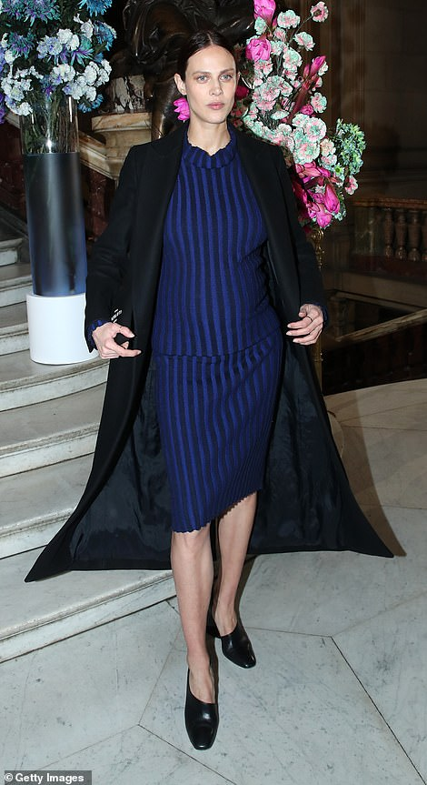 Out and about: Aymeline Valade cut a stylish figure in a blue pinstriped dress with a black overcoat