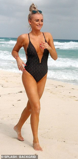 Weight loss: Displaying her incredibly toned frame, the soap actress turned heads in her black patterned one-piece, which featured a low-cut neckline