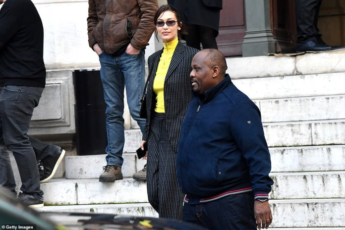 Friendly: She was joined by her bodyguard as she headed in and out of the venue in the stunning French capital