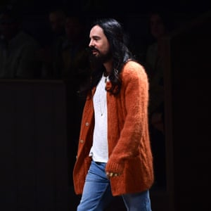 The fashion designer Alessandro Michele appears after his Gucci men's autumn-winter show in Milan.