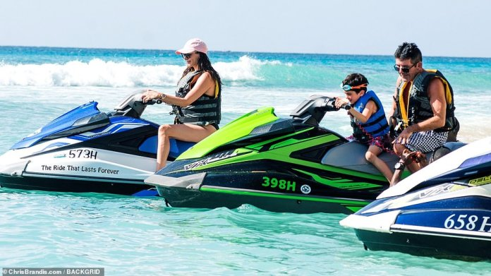 Let's do this:Lauren joined Eric and Simon on the jet skis, with the socialite taking one jet ski, while Simon and Eric zipped along on another