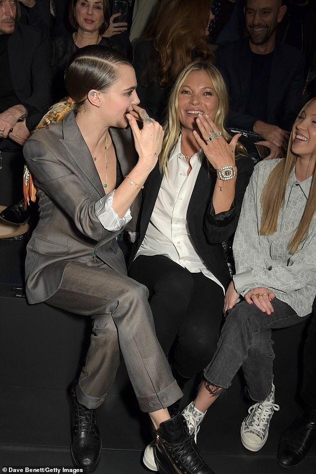 Fun times: Cara was in very animated spirits as she cosied up to Kate, with the two seen laughing and giggling together
