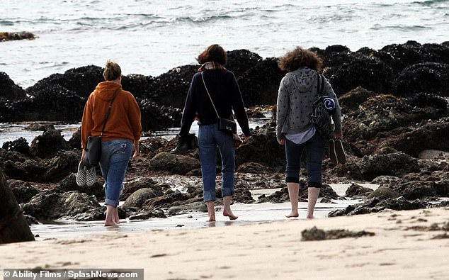 Footprints in the sands: The ladies hit a rocky patch as they continued their saunter down the beach