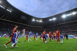 The two teams walk out before kick-off.