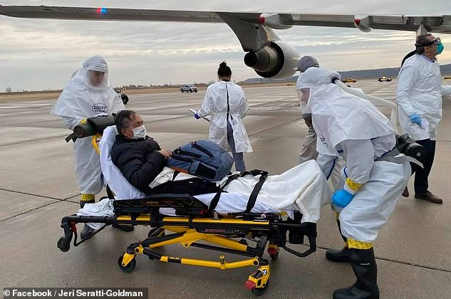 Jeri Seratti-Goldman says her husband, Carl Goldman, has tested positive for coronavirus and has been placed in a special biocontainment unit in Nebraska. Pictured: Carl arrives in Nebraska and is placed on a stretcher to be taken to Nebraska Medicine