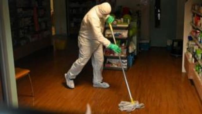 Man mopping a surgery floor