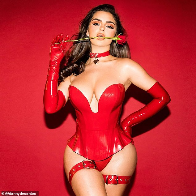 'Not your Valentine': Demi Rose, 24, set pulses racing in an all red latex bodice, knicker and glove outfit, complete with a thorny rose between her lips