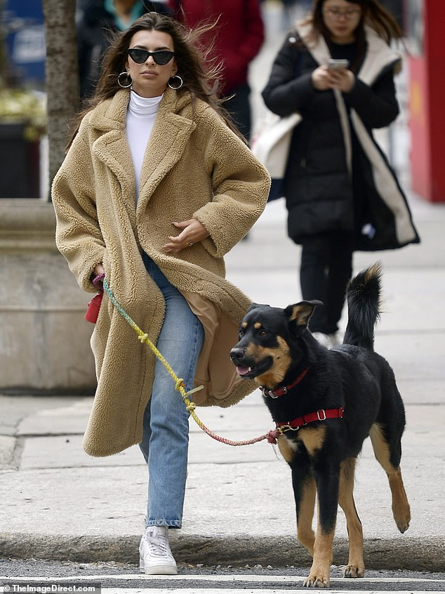 Sunday stroll: Emily Ratajkowski looked chic as she took her dog Colombo for a walk on Sunday